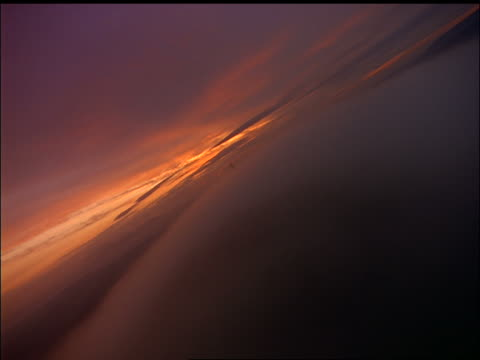 Airplane point of view over clouds with communications tower poking thru at twilight / County Waterford, Ireland