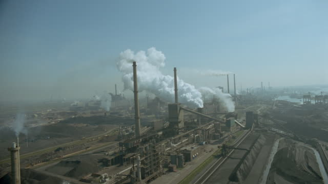 aerial airplane point of view over smokestacks of factory / ijmuiden, noordzeekanaal, holland - north sea canal stock videos & royalty-free footage