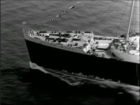 B/W AERIAL airplane point of view Queen Mary ship on ocean