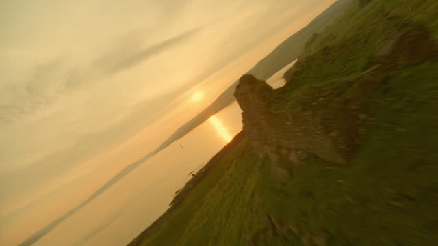 aerial airplane point of view silh.castle ruins on ardtornish point to boat at sunset / isle of mull, scotland - twilight stock videos & royalty-free footage