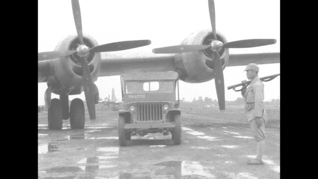 ms airplane propeller spinning / indian women draped in white traditional dress carrying baskets on head walking single file on tarmac with boeing... - world war ii stock videos & royalty-free footage