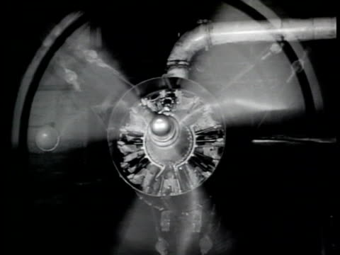 Airplane propellers turning creating optical illusion of reverse spin MS Airplane gauge Man pulling metal piece out of stamping machine Two men...
