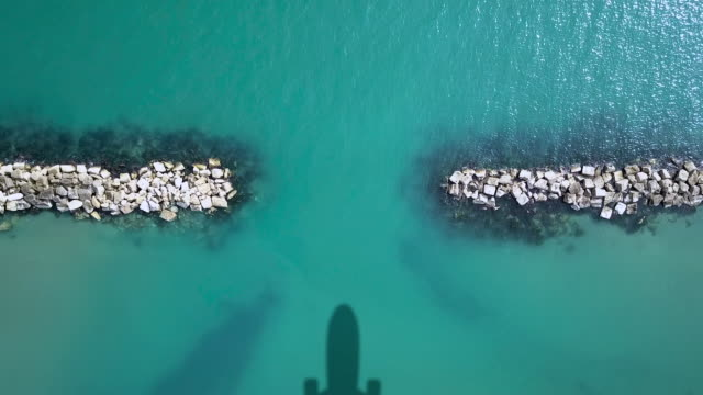 Airplane shadow on the sea