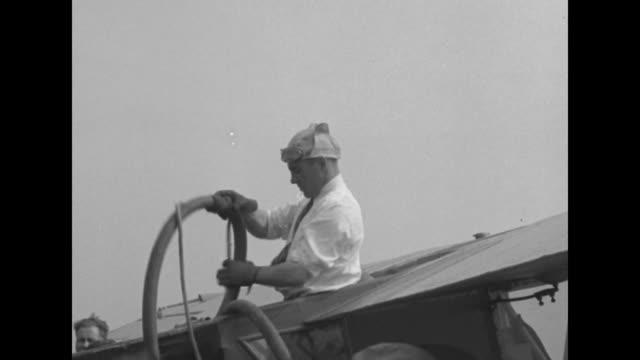 MS airplane 'Spokane SunGod' flying/ VS it flies overhead / pilot Nick Mamer standing on wing refueling plane at Roosevelt Field Long Island NY /...