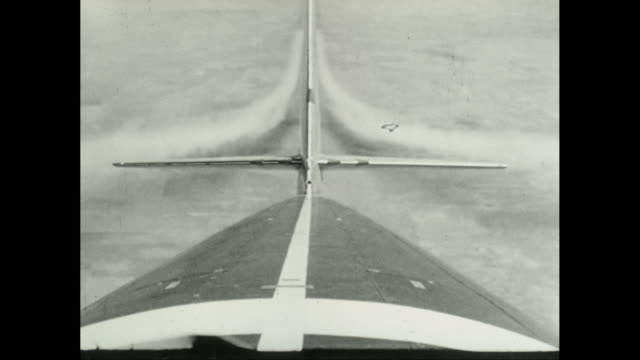 ms td pov of airplane tail as it  flys over landscape / united states - airplane tail stock videos and b-roll footage