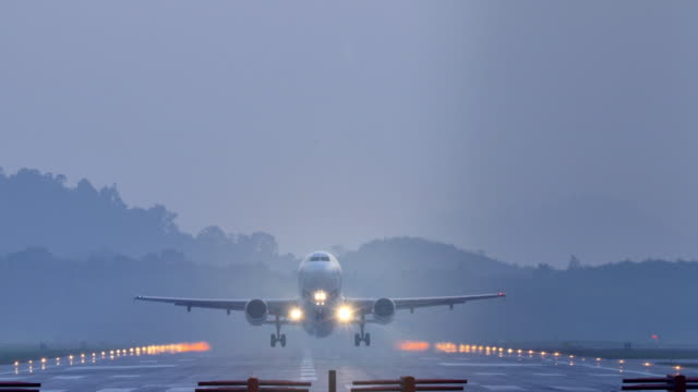 airplane take off at dusk. - aeroplane stock videos & royalty-free footage