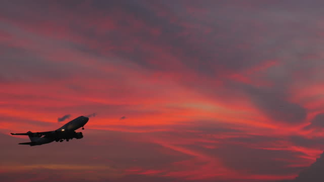 airplane take off at sunset time - taking off stock videos and b-roll footage