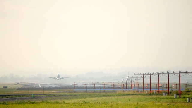 HD airplane take off early morning haze