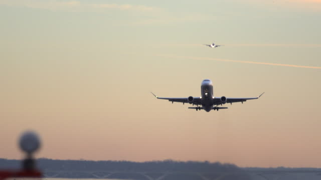 airplane takes off at sunset - taking off stock-videos und b-roll-filmmaterial