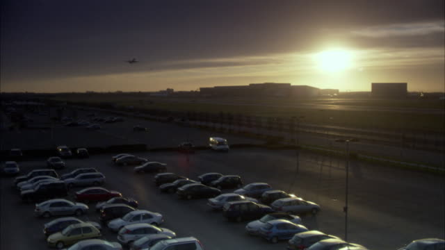 ws airplane taking off at heathrow airport at dusk / london, uk - heathrow airport stock videos and b-roll footage