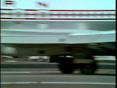 1970 MONTAGE MS Airplane taking off at LAX and apartment building, Los Angeles, California, USA, AUDIO