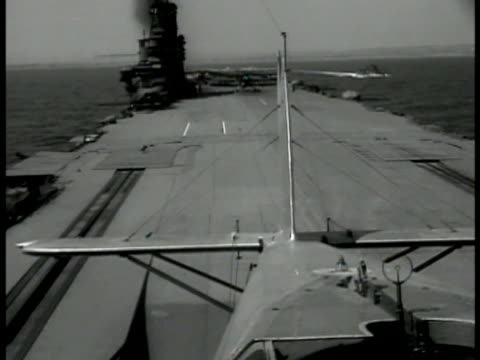 airplane taking off from english aircraft carrier at sea tail wing fg. world war ii wwii royal navy. - aircraft carrier stock videos & royalty-free footage