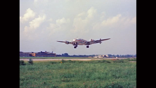 vídeos de stock, filmes e b-roll de ws ts airplane taking off from runway / united states - 1960