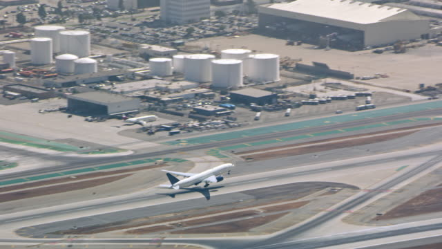 aerial airplane taking off from the airstrip in ca - airport runway stock videos & royalty-free footage