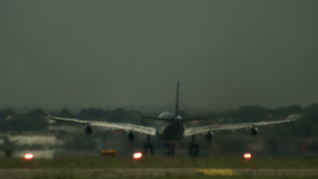 airplane taking off in slow-motion - taking off stock videos & royalty-free footage