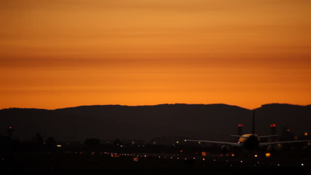 hd airplane taking off in sunset - portland oregon sunset stock videos & royalty-free footage