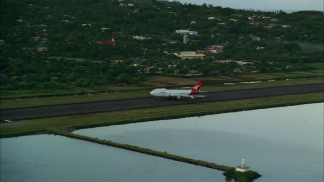 aerial ws ts airplane taking off over water / tahiti, french polynesia - tahiti stock videos and b-roll footage