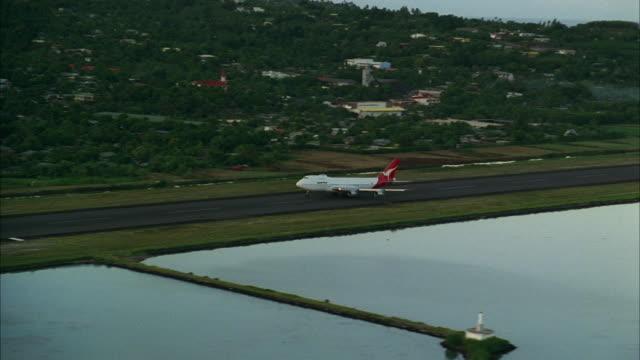 aerial ws ts airplane taking off over water / tahiti, french polynesia - tahiti stock videos & royalty-free footage