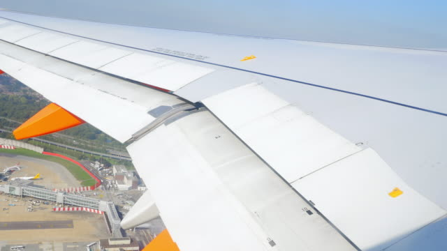 aerial pov airplane taking off (4k/uhd) - gatwick airport stock videos & royalty-free footage