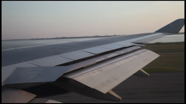 airplane taking-off view through window, new york jfk airport, usa - aircraft wing stock videos & royalty-free footage