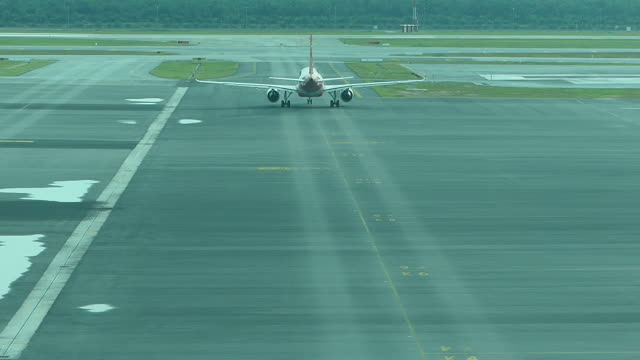 airplane taxiing at the airport - kuala lumpur stock videos & royalty-free footage