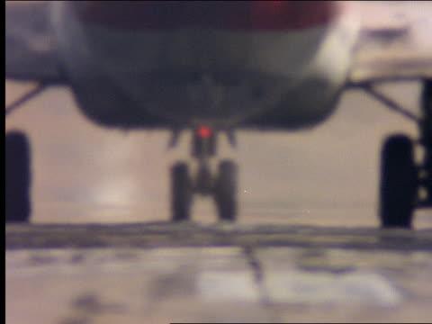 Airplane taxiing on runway / heatwaves