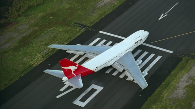 AERIAL WS PAN Airplane Taxiing On Runway / Tahiti, French Polynesia