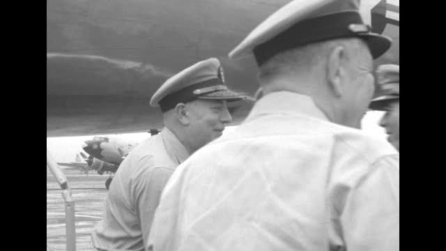 airplane taxiing towards camera / adm. william fechteler, chief of naval operations, comes down steps of plane and is greeted at bottom by gen. james... - vangen stock-videos und b-roll-filmmaterial