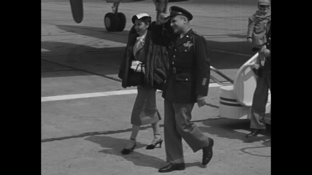vs usaf airplane taxis on runway at orly airfield in paris honor guard stands nearby / us gen matthew ridgway and wife mary deplane as officials wait... - matthew b. ridgway stock-videos und b-roll-filmmaterial