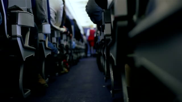 airplane travel.stewardess and passengers during a flight - cart stock videos & royalty-free footage