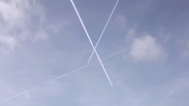 Airplane vapor trails in the sky