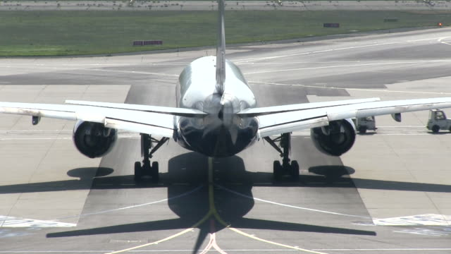 ms airplane waiting at taxiway for moving traffic infront of plane / frankfurt, hesse, germany   - taxiway stock-videos und b-roll-filmmaterial