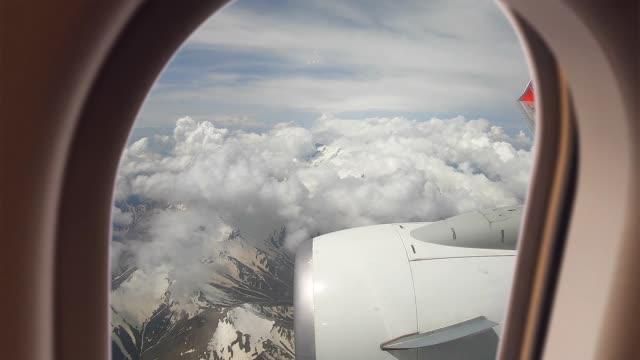 vidéos et rushes de fenêtre d'avion - hublot