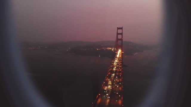 airplane window view with the golden gate bridge at rush night in san francisco. - creativity stock videos & royalty-free footage