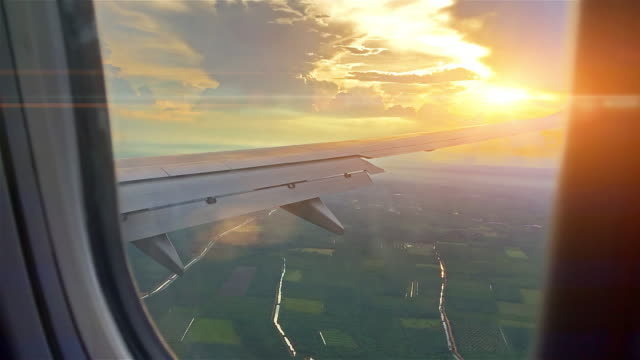 airplane wing and sky view from window at dusk - window stock videos & royalty-free footage