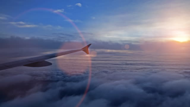 airplane wing and sky view from window at dusk - aircraft wing stock videos & royalty-free footage