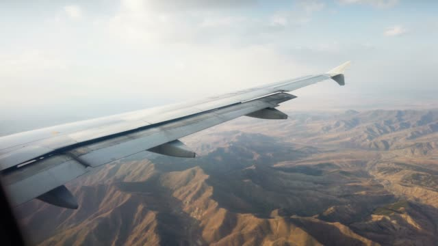 airplane wing and sky view from window - aircraft wing stock videos & royalty-free footage