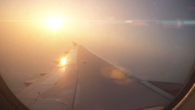 airplane wing and sky view from window. - 1976 stock videos & royalty-free footage