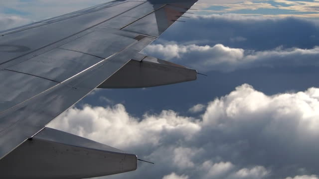 airplane wing in front of clouds - airplane part stock videos and b-roll footage