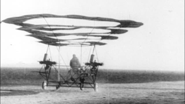 stockvideo's en b-roll-footage met airplane with circular sails unsuccessfully attempts to fly early failed flight invention on january 01 1915 in unspecified - 1915