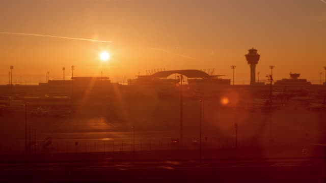 stockvideo's en b-roll-footage met airplanes and various vehicles move across the tarmac at the munich airport in munich, germany. - münchen vliegveld