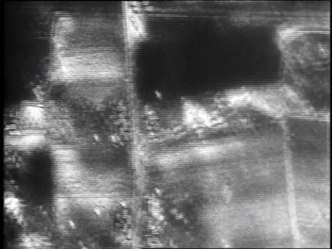 airplanes drop bombs on railway targets on the ground / luneburg, germany - リューネブルグ点の映像素材/bロール
