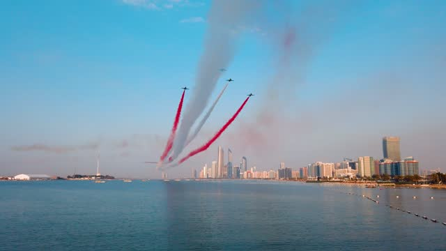 airplanes flying above abu dhabi skyline in the uae for the national day celebration - airshow stock videos & royalty-free footage