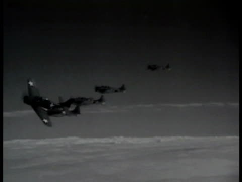 airplanes line on tarmac man adjusting propeller aerial naval airplanes flying in formation each 'peeling off' out of frame aerial above naval tbf... - 爆撃機点の映像素材/bロール