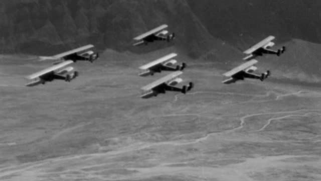 airplanes of the 11th bomb squadron under command of lieutenant charles h howard take to the skies from march field on the initial patrol through /... - 1932 stock videos and b-roll footage