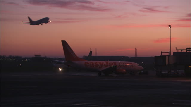 WS Airplanes on tarmac at dusk, Belfast Airport, Ireland, United Kingdom