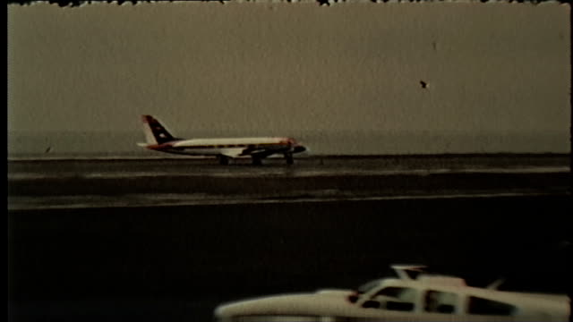 wgn airplanes on the runway of a chicago airport in january 1968 - o'hare airport stock videos & royalty-free footage