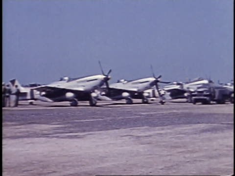 airplanes parked at airfield / iwo jima, japan - airfield stock videos & royalty-free footage