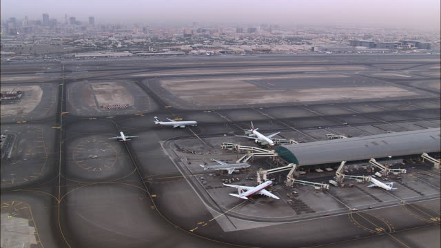 AERIAL Airplanes parked at airport, Dubai, United Arab Emirates