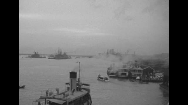 airplanes taking off from airstrip in the distance / boats steaming on the yangon river / american flag on side of ship / cargo crane lifting cargo... - ford truck stock videos and b-roll footage